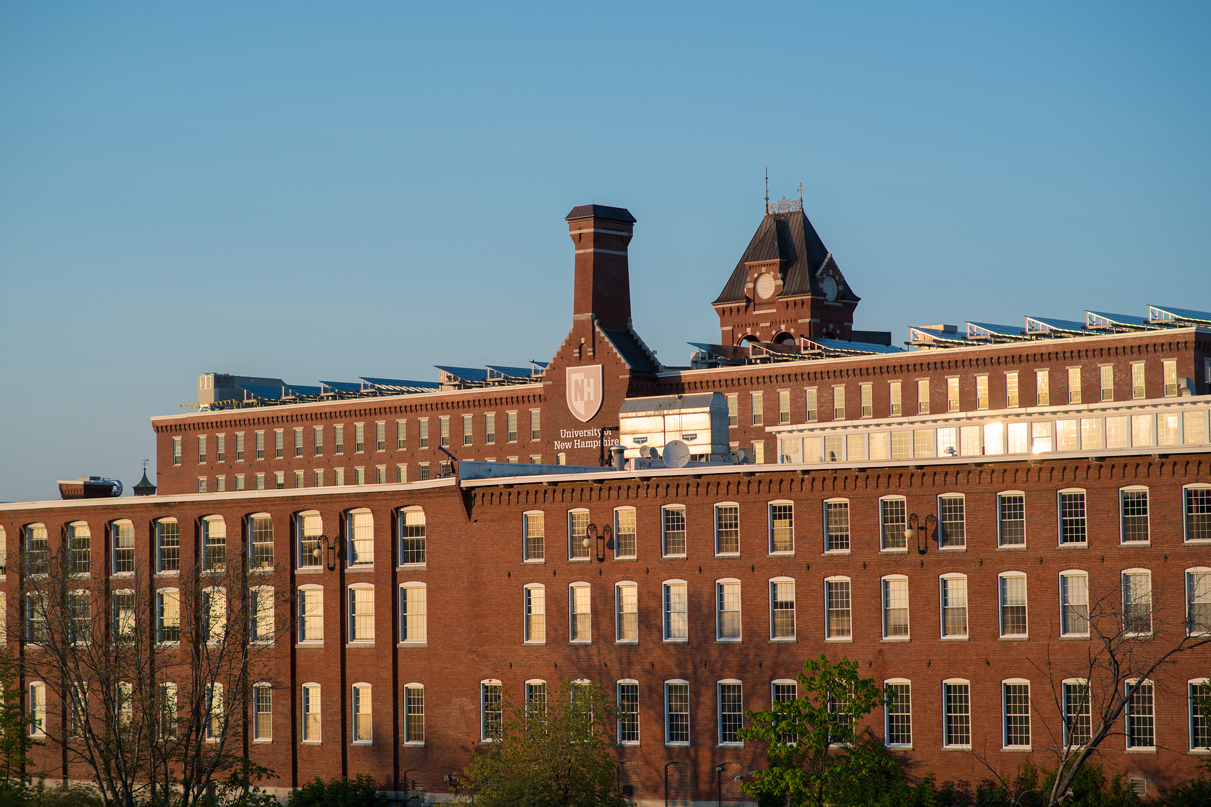 A scenic view of UNH Manchester's brick building in the millyard.
