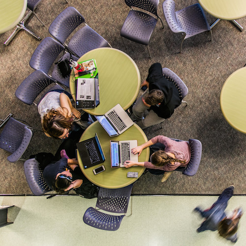 Overhead shot of students studying at a round table