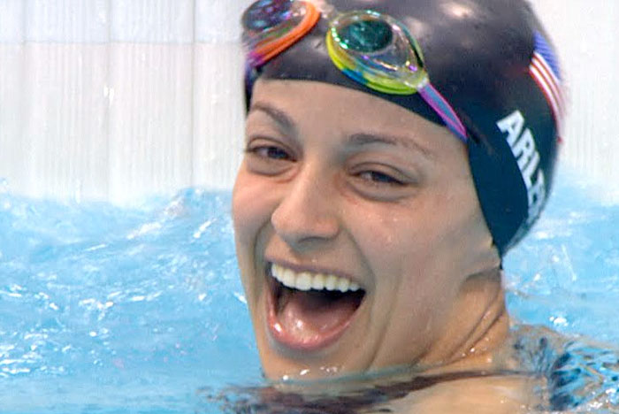 Paralympic swimmer Victoria Arlen finishing race in pool