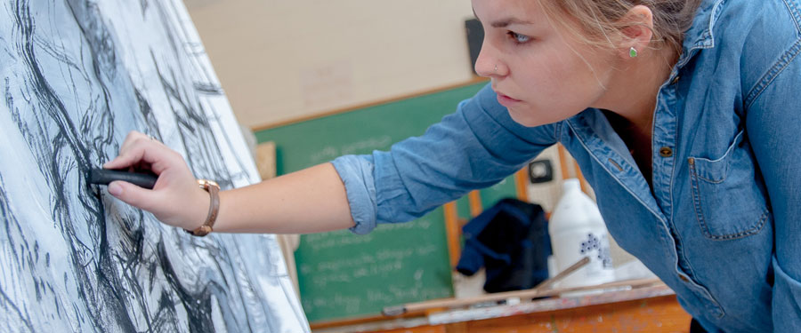 female student in art class