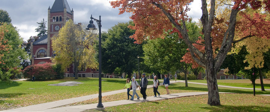 view of Thompson Hall with students in Autumn