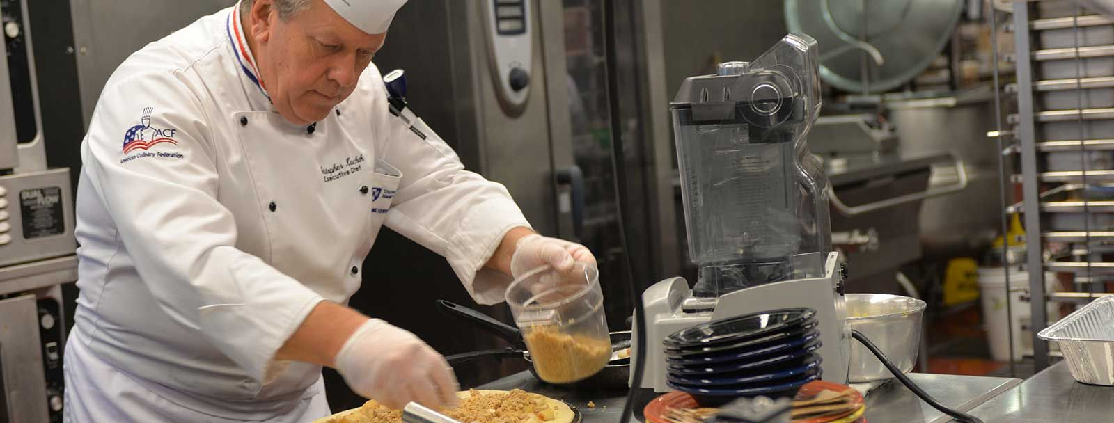 UNH Executive Chef Chris Kaschak makes apple-cheddar pizza