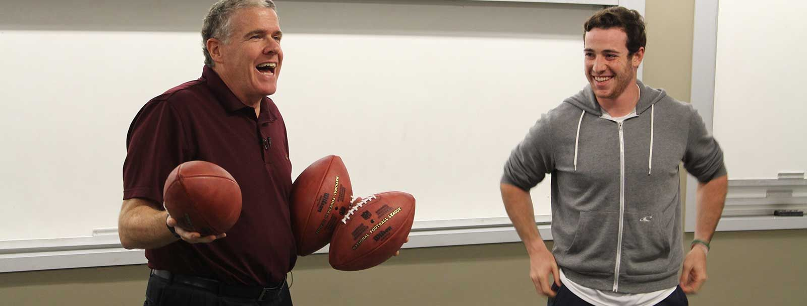 SI's Peter King and UNH quarterback Adam Riese
