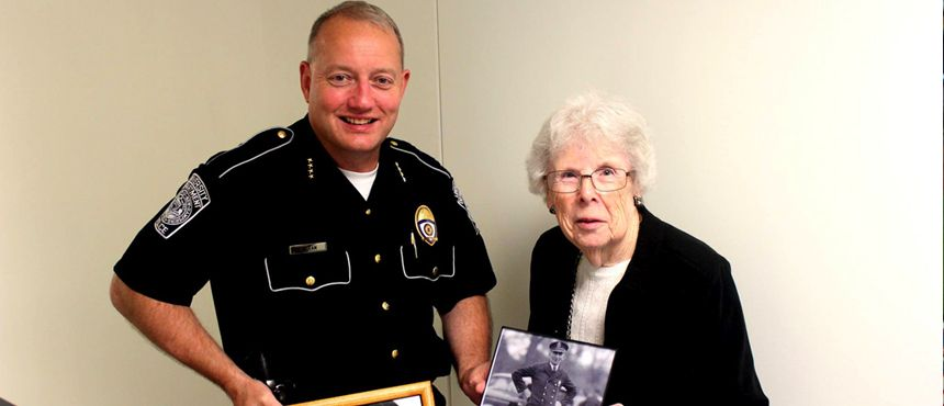 Chief Dean with Dolly Markey, the youngest daughter of our department's first police chief Louis Bourguoin.