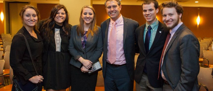 UNH alumnus meets group of UNH students