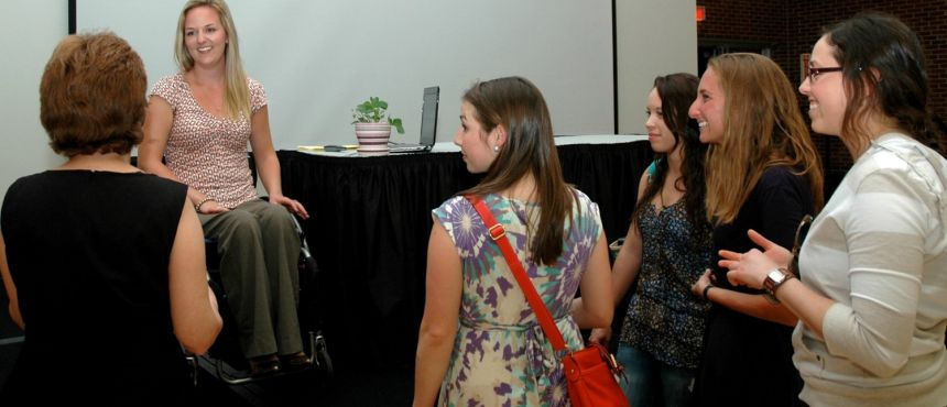 Monica Quimby talking with students