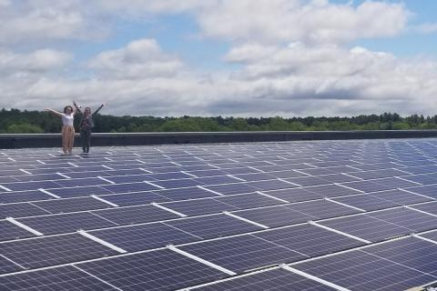 students standing at solar array