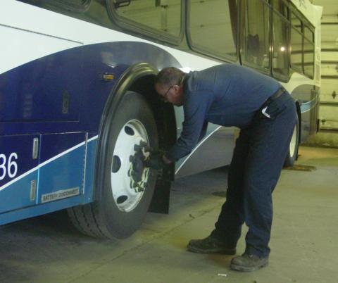 Man working on a bus