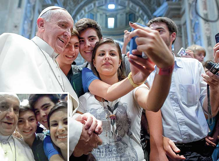 Pope Francis posing for a selfie with teenagers