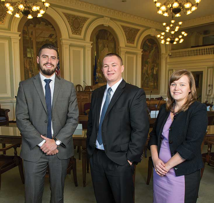 UNH political interns Dan Zotos '14, Tyler Clark '13 and Brittany Weaver '10