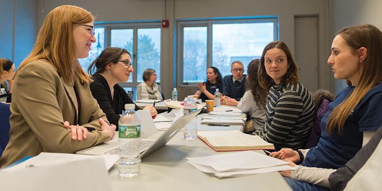 Alecia Magnifico, assistant professor of English at UNH, and other members of the Dialogues Group