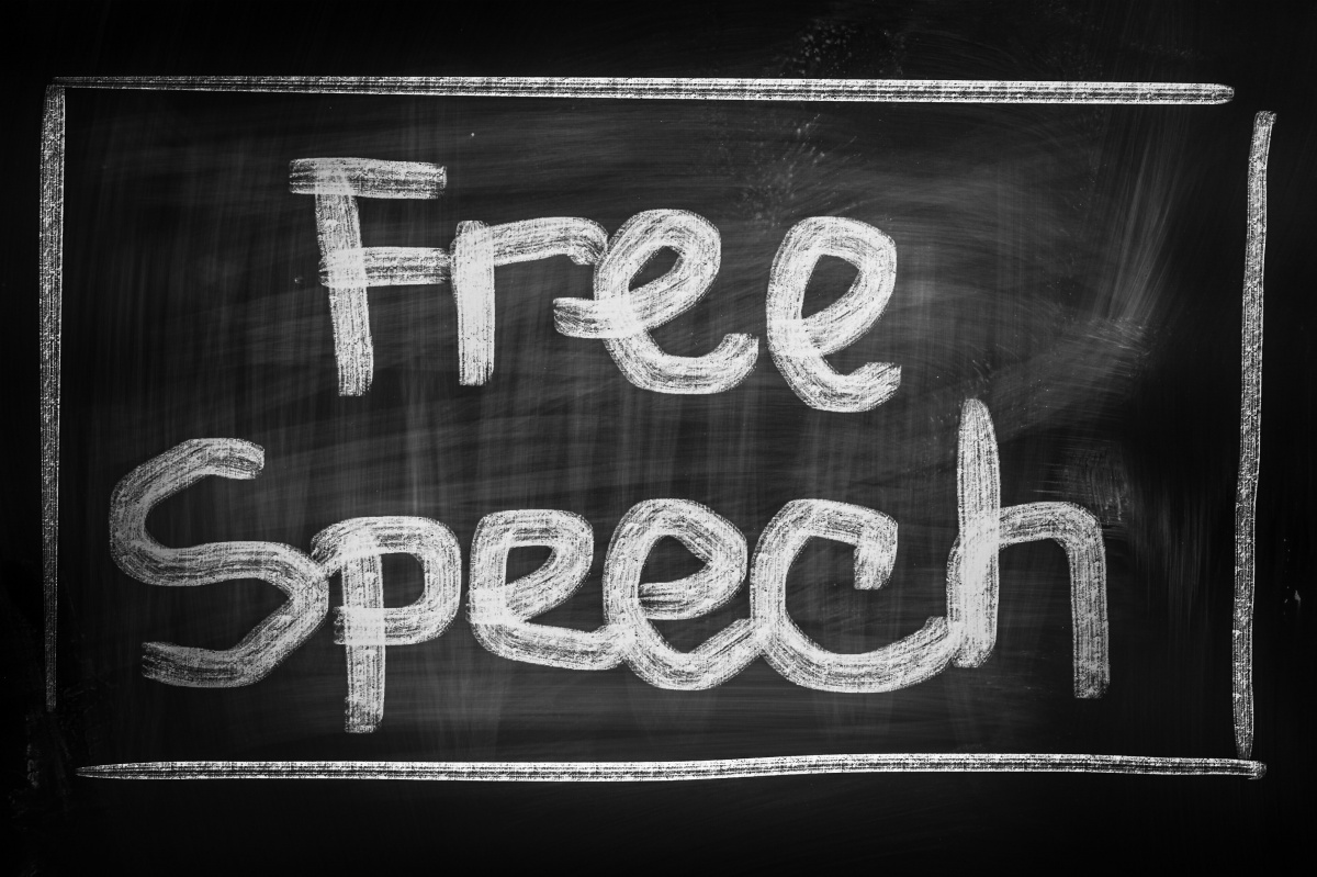"image of a blackboard that says ""free speech"""