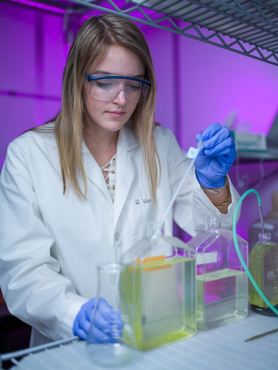 UNH student Emily Ray, in the laboratory