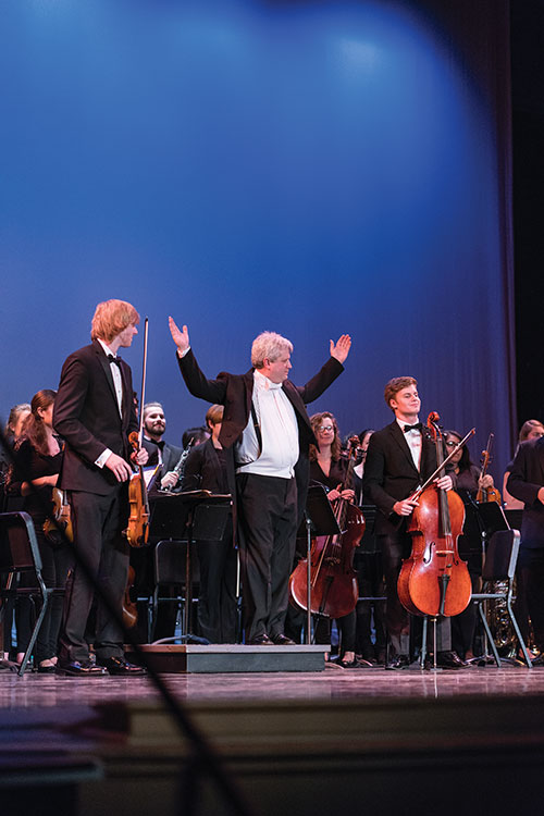 Members of the UNH orchestra with conductor David Upham during a 2017 performance at the Music Hall in Portsmouth, New Hampshire