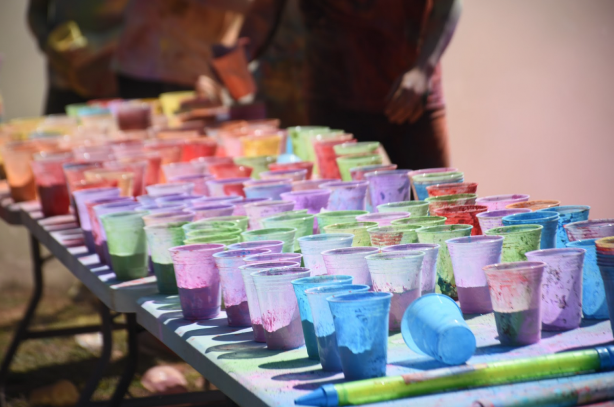Cups filled with colorful chalk dust at UNH Holi celebration