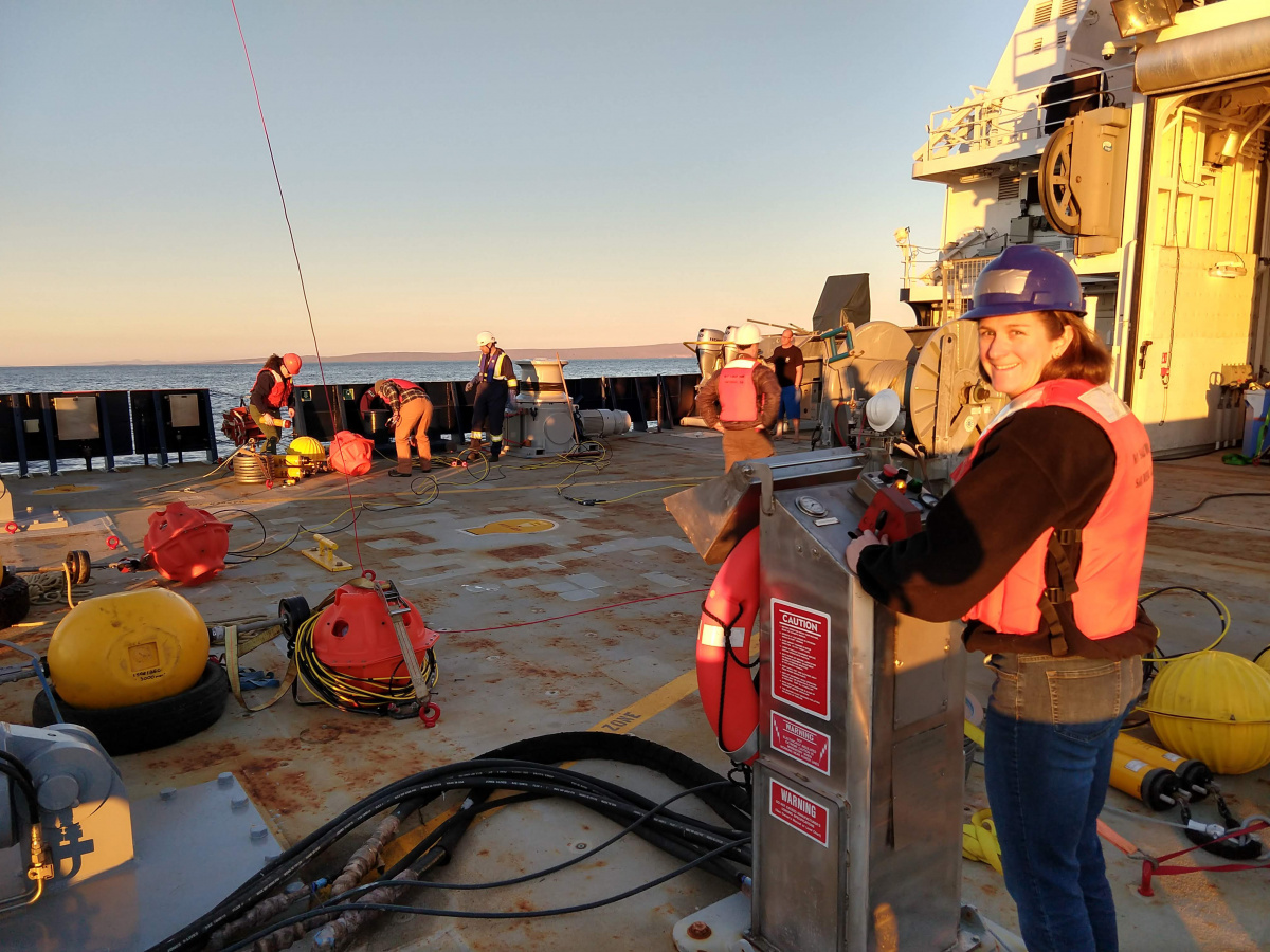 Jennifer Miksis-Olds stands on research vessel