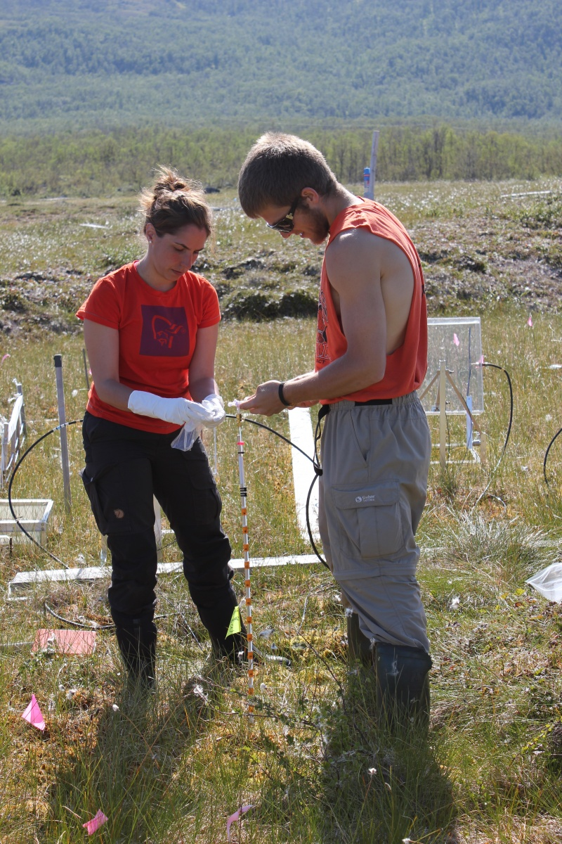 UNH researchers take water samples in Sweden.