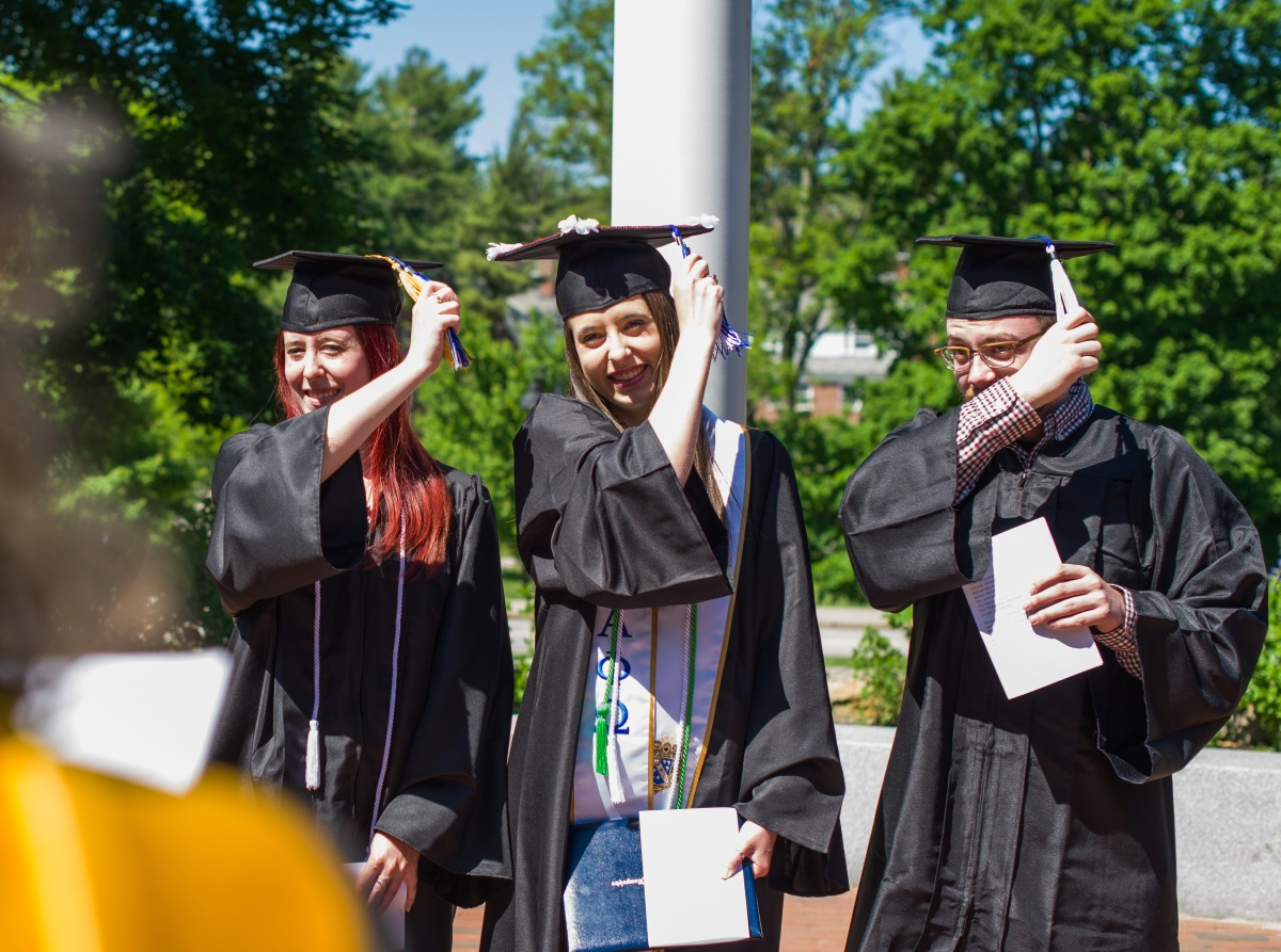 "Jessica Nadeau (center) turns her tassel during her ""recommencement."""