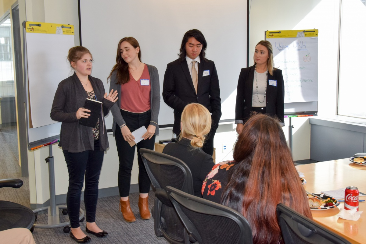Students present during a visit to Brodeur Partners in Boston.