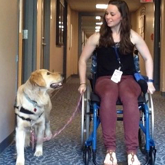 UNH alumna Jennifer Blessing training a service dog