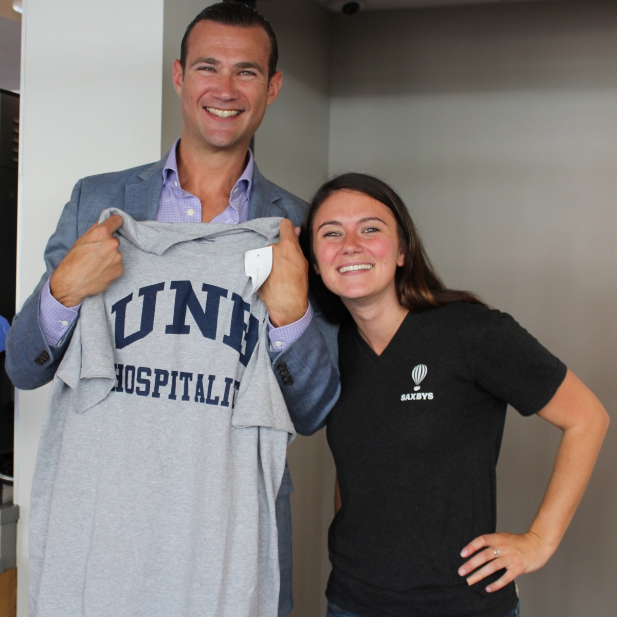 Crowe with Saxbys CEO Nick Bayer after gifting him with a UNH Hospitality T-shirt