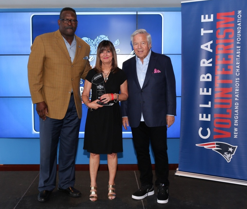Louise Griffin with Andre Tippett and Robert Kraft