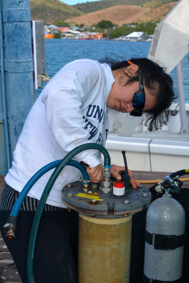 Graduate student on deck of research vessel
