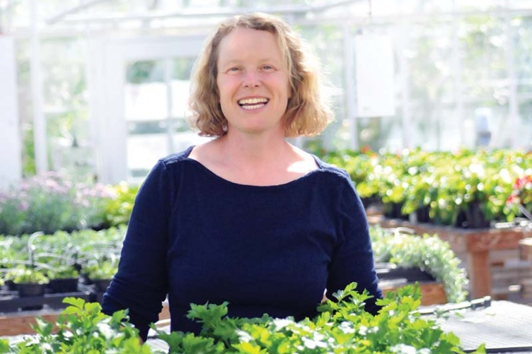Researcher Becky Sideman in a greenhouse