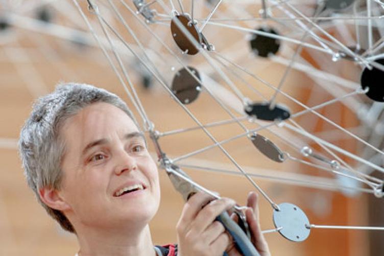 anna hepler installing sculpture at paul college