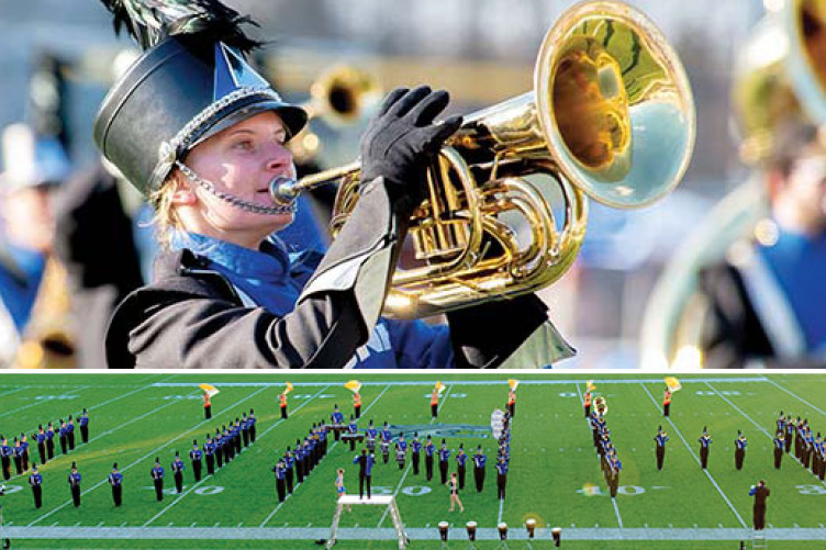 student in marching band; UNH spelled out by marching band on football field.
