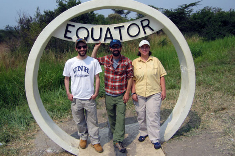 students at equator sign