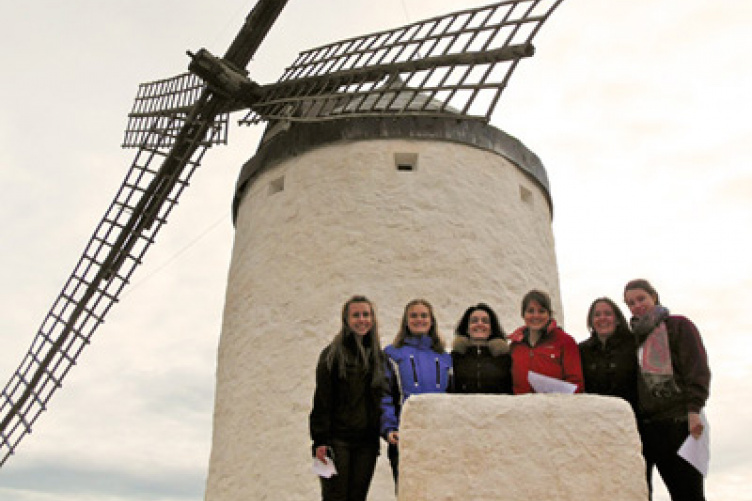 students in spain in front of windmill