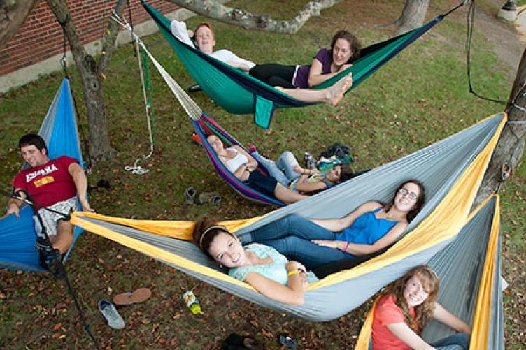 students relaxing in hammocks