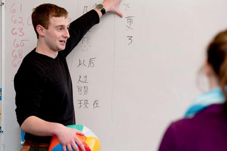 matt jones, with beachball, teaching chinese