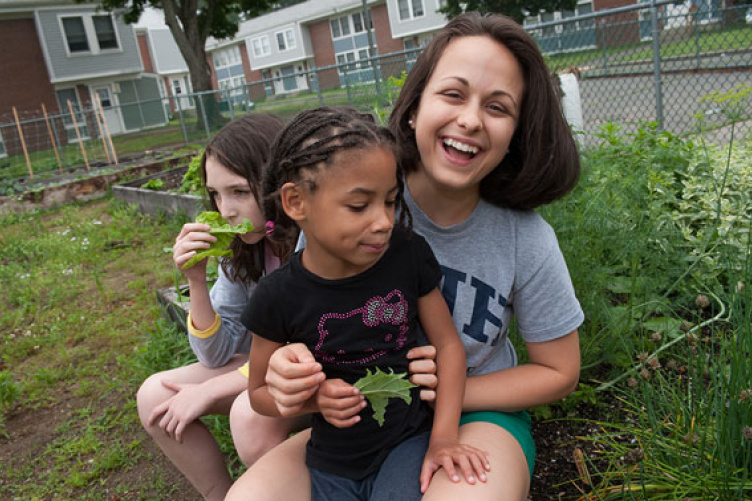 sarah garstka with kids in garden