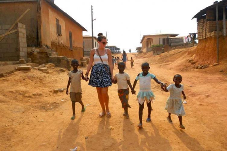 in Ghana, holding children's hands