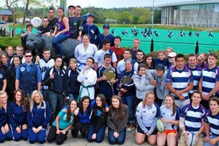 representatives from various rec sports teams, in front of Cat sculpture