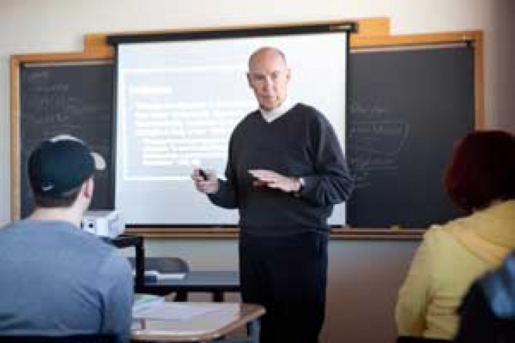 unh manchester history professor teaching a class