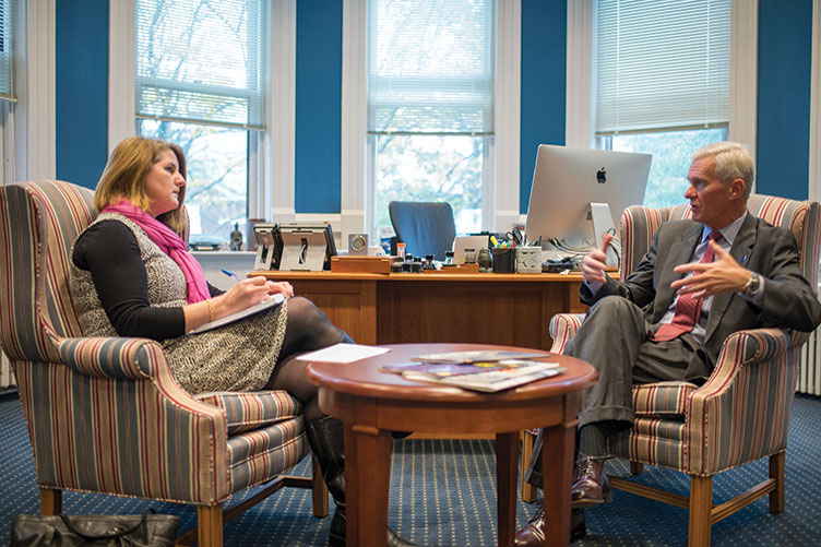 UNH Magazine Editor-in-chief Kristin Waterfield Duisberg talking with President Mark Huddleston
