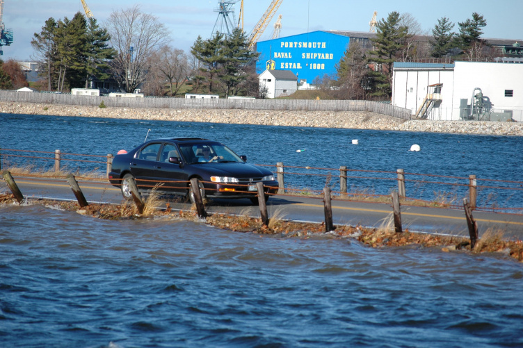 Car driving on a flooded roadway