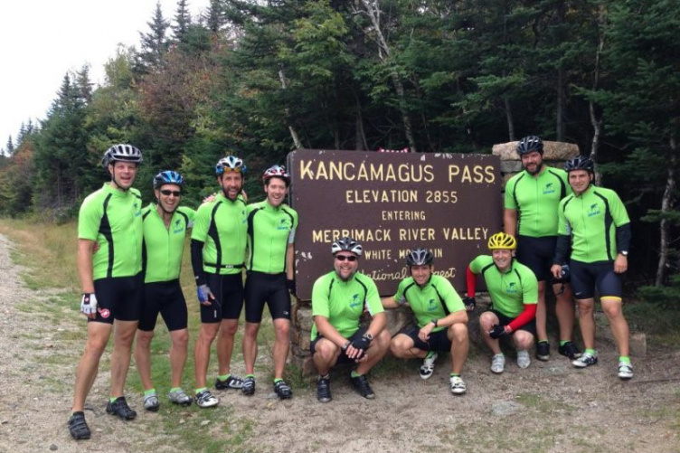 Group of alums gather at the Kanca sign