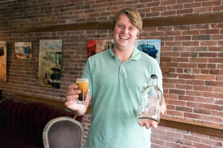 UNH graduate Connor Roelke in his nitro cold brew coffee shop