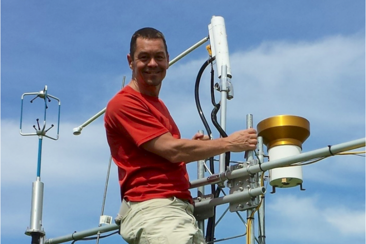 Researcher Scott Ollinger on a research tower