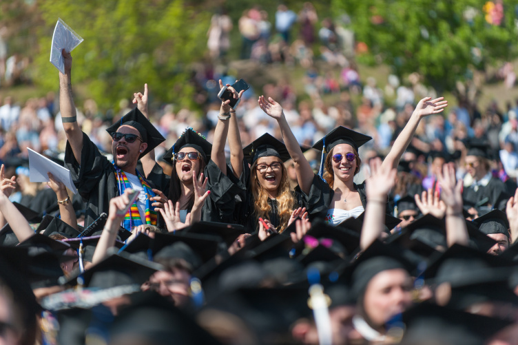 UNH students cheer at commencement.
