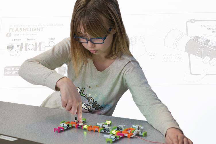 a young girl playing with LittleBits at East Rochester School