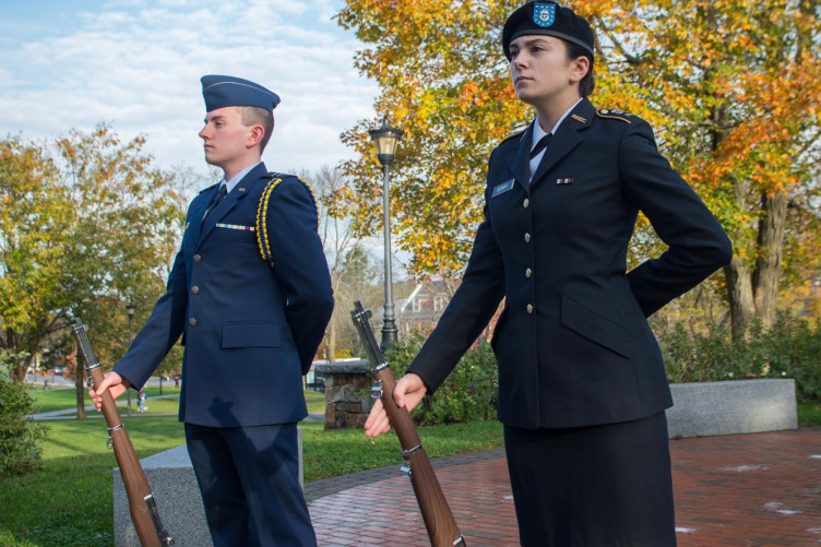 Two UNH ROTC students holding vigil at flag at Thompson Hall