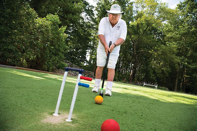UNH alumnus Bert Myer '67 playing croquet