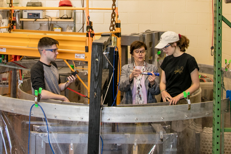 UNH Professor Nancy Kinner working with students.
