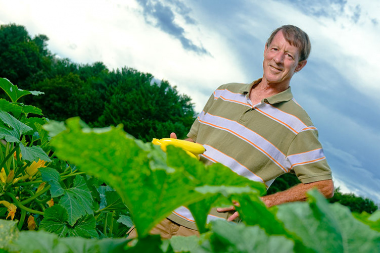 UNH professor emeritus J. Brent Loy with Slick Pik summer squash