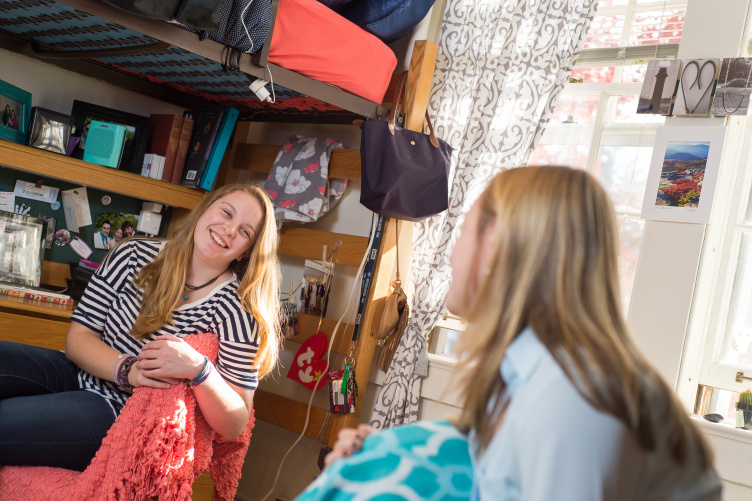 Photo of two female roommates laughing